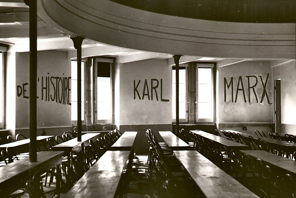 """Classroom at the University of Lyon with markings on wall reading """"DE L'HISTOIRE KARL MARX,"""" made during student occupation of parts of the campus as part of the May 1968 events in France."""
