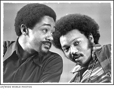 Bobby Seale, left, co-founder of the Black Panther Party, and Jesse Jackson, right, future two-time candidate for the Democratic presidential nomination, talk on March 12, 1972 at the National Black Political Convention in Gary, Indiana.