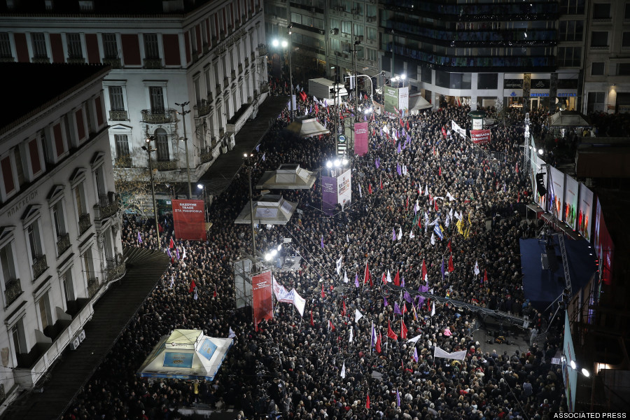 Supporters of Alexis Tsipras, leader of Greece's Syriza left-wing main opposition party attend his pre-election speech at Omonia Square in Athens on Thursday, Jan. 22, 2015. Prime Minister Antonis Samaras' New Democracy party has failed so far to overcome a gap in opinion polls with the anti-bailout Syriza party ahead of the Jan. 25 general election. (AP Photo/Petros Giannakouris)