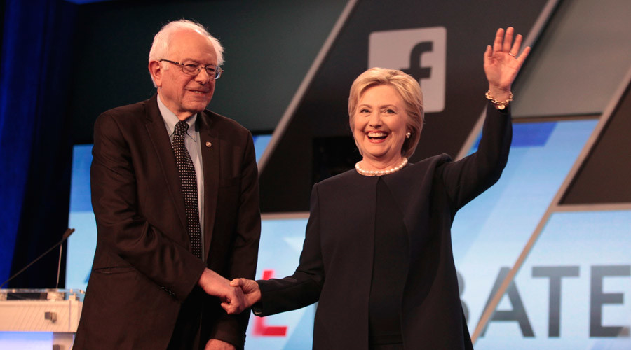 Democratic presidential candidates Bernie Sanders and Hillary Clinton shake hands before the start of the Democratic Party debate on March 9, 2016. © Javier Galeano / Reuters