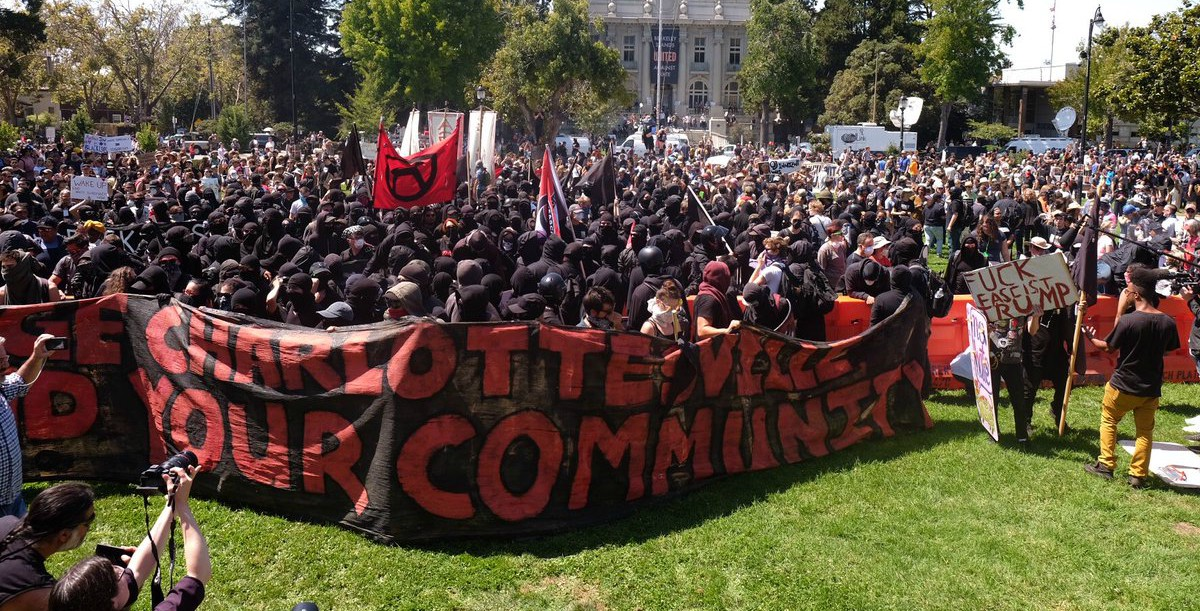 """A banner reading """"Avenge Charlottesville / Defend your community"""" at the counter-protest for """"No To Marxism"""" rally in Berkeley, California, on August 27, 2017."""